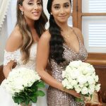 Bride and her bridesmaid with bouquets