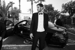 groom waits for his bride in suit from Astor & Black