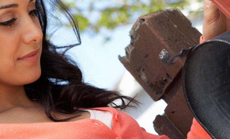 Woman mailing invitations at a mailbox